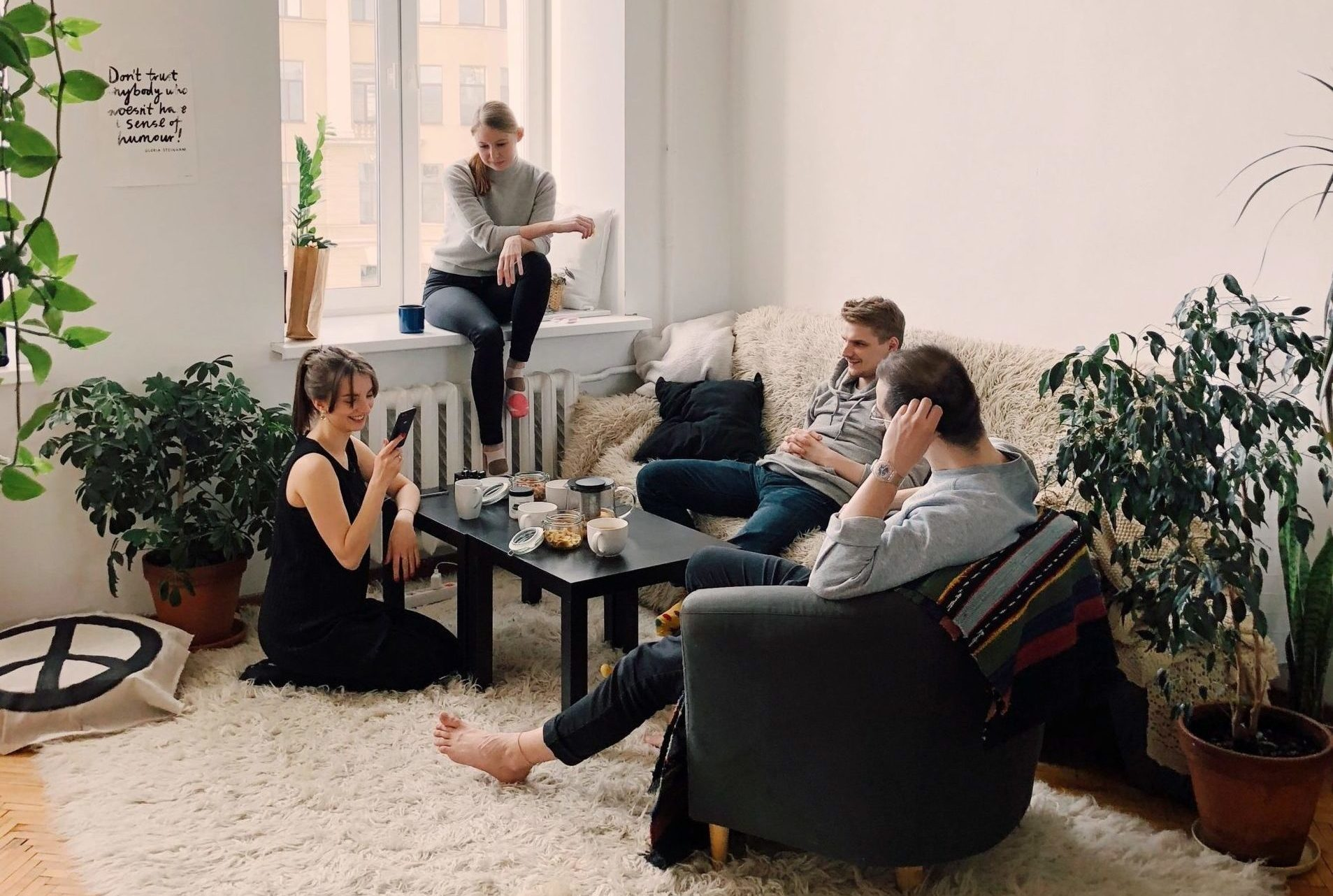 people-gathered-inside-house-sitting-on-sofa